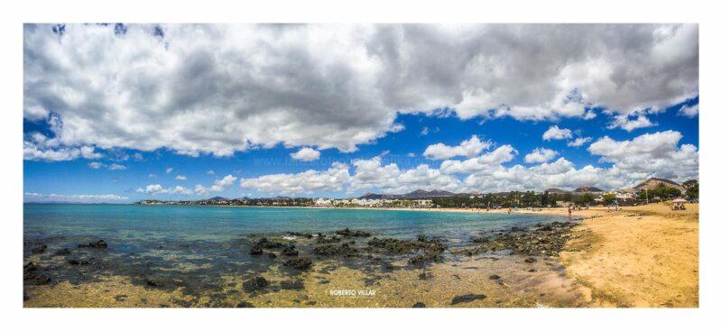 Fotografía original en formato panorámico de la Playa de Los Pocillos en Puerto del Carmen, Lanzarote,